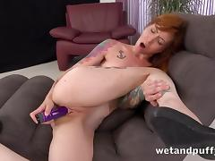 Hot redhead pornstar pumps her pussy before toy play