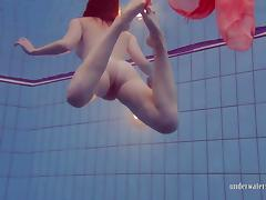 Redhead in the pool porn tube video