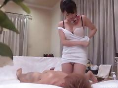 Masseuse has a very sexy way of giving a massage to her customer
