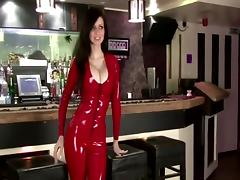 Lily in red latex catsuit