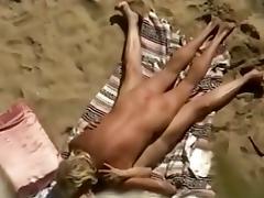 Outdoor sex on beach filmed through from top by a voyeur cam tube porn video