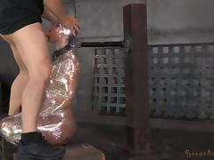 Redhead tied up with nylon has to suck the dicks of her captors porn tube video