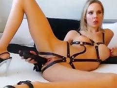 Blonde vixen in leather straps dildo fucks her holes
