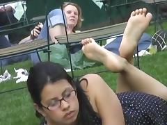 Candid feet soles in the pose at park