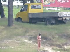 Ola walking alone naked on a public beach (voyeur version)