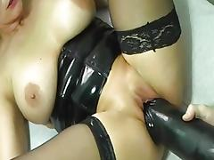 Blonde takes on colossal dildo
