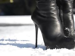 julie skyhigh walking on ice, high heels boots leather skirt