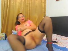 Sexy latina milf strips and toys on cam wearing stockings and heels