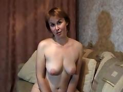 Blonde mature milf at home stripteasing and fingering her pussy porn tube video