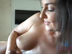 Brittany Shae uses  her feet and gets cum on her tits