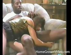 Two black stallions have a fun time with a gorgeous brunette