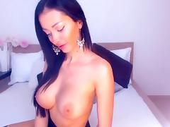 Brunette SexyyyANGEL licks rubber penis