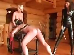 Two dominatrix whip slave