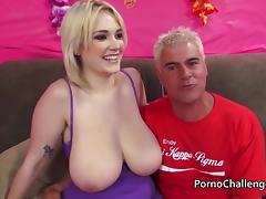 Huge natural boobed blonde eats a cumshot