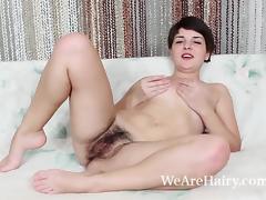 Rubina strips and masturbates on her bed