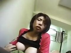 Big breasted Oriental cutie with a phenomenal ass sucks a h porn tube video