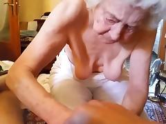 Granny massages a dick