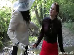 Lesbo clothed sluts get wet in the river tube porn video