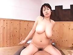 Sensuous Japanese masseuse with big natural hooters fucks a