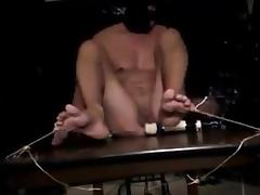 Tied to table and vibrated