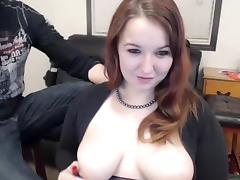 Curvaceous young brunette exposes her big natural boobs on tube porn video