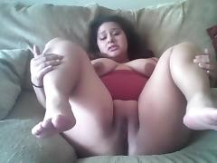 Lusty Lavish shakes her ass and rubs her pussy