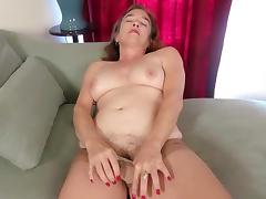 American gilf Melody Garner rubs her hairy pussy porn tube video