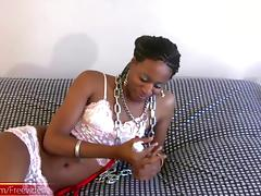Black shedoll in pink lingerie inserts long dildo quite deep