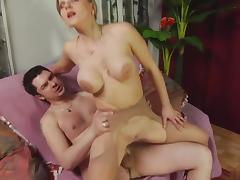 Busty blonde in stockings gets doggy style fuck porn tube video