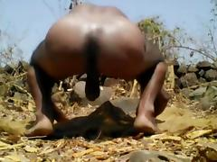 Village boy nude in forest and play with tree