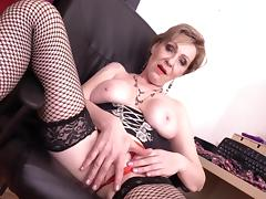 busty mature masturbates in the office