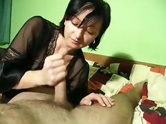 Sultry cougar makes the moves to satisfy her horny husband'