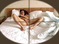 Slender brunette lies naked on the bed and brings herself t porn tube video
