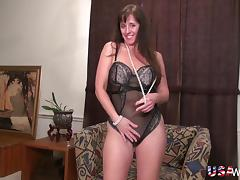 Horny mature lady stripping down and masturbating using adult toys