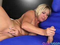 Busty milf jerks cock of a man in spandex porn tube video