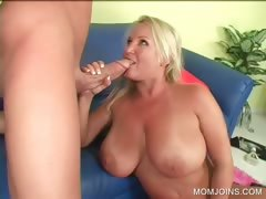 Slutty MILF gives tit job on the couch tube porn video