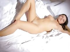 Busty chick wow stripping on a bed