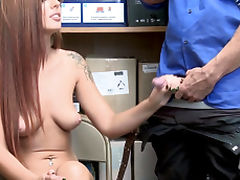 Stunning redhead gets banged from behind by a horny officer