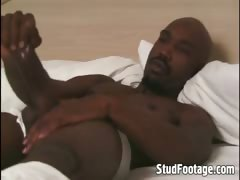 Sexy black guy jerking off in his bed