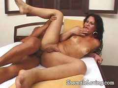 Hot shemale rides her ass on a big cock