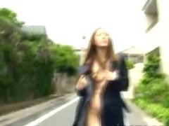 Nudist Japanese beauty goes naughty sucking toy in parking lot