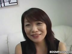 Horny Asian slut with big boobs sucks