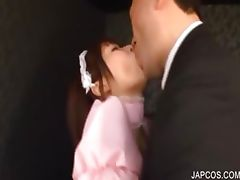 Asian maiden erotically kissing a guy