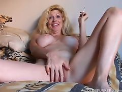 Beautiful blonde milf enjoys a smoke naked tube porn video