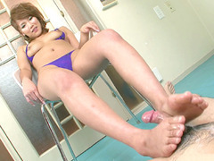 Akiho Nishimura stroking it up and down it with her feet and making it extra hard tube porn video