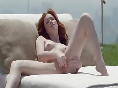 Beautiful redhead opening pussy outside