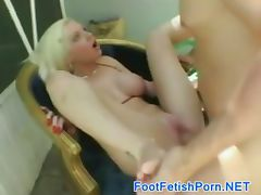 Blonde slut gives footjob