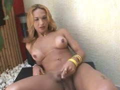 Foxy blonde tranny babe plays with her cock and ass