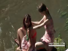 Lesbo teen duo touching bodies outdoor