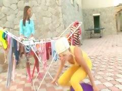 Girly fun outdoors of two schoolgirls